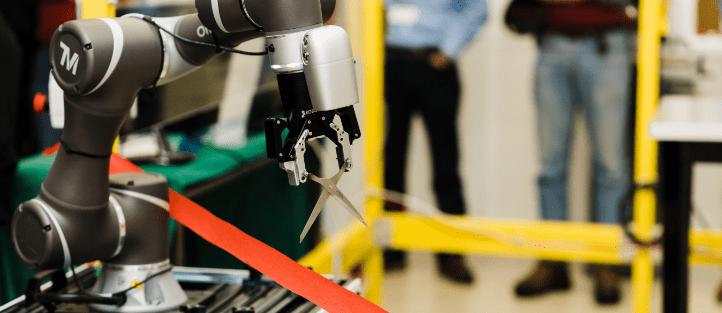 robot cutting ribbon